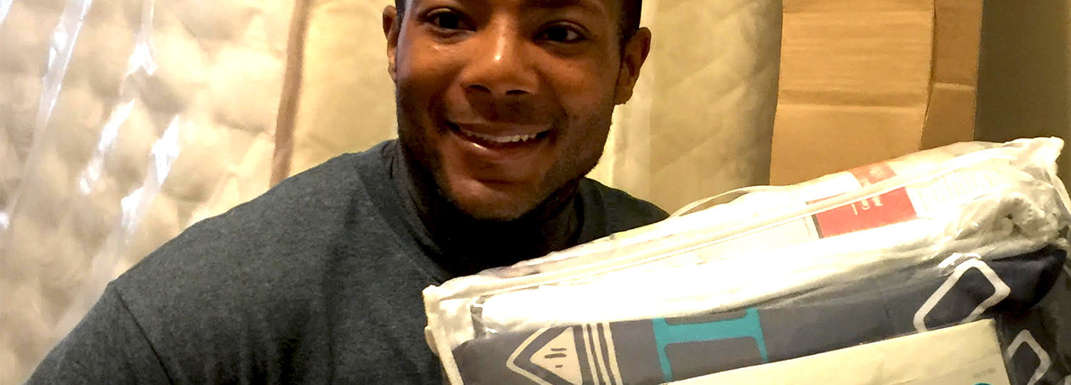 TGCP's Sweeter Dreams volunteer delivering a new bed, bedding to Wake County children