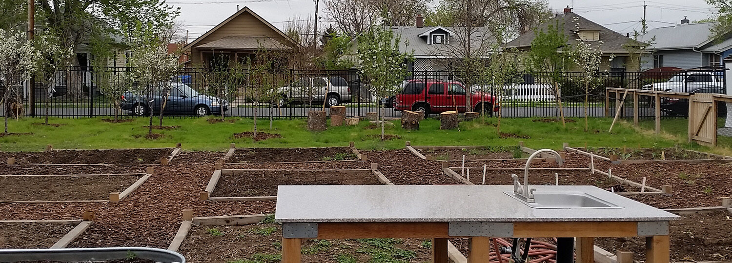 work table and garden plots in a large fenced-in area