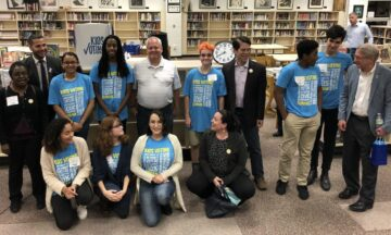 Group shot of diverse high school students in a school library.